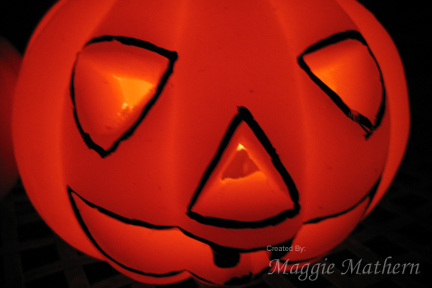 Jack-O-Lantern lit with candle from within