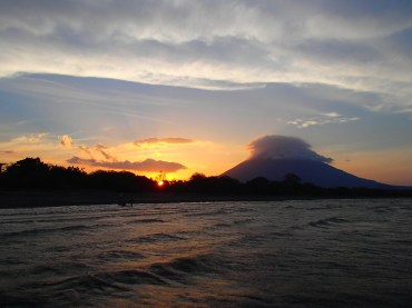 Santa Domingo beach on Ometepe Island looking at Volcano Conception at sunset