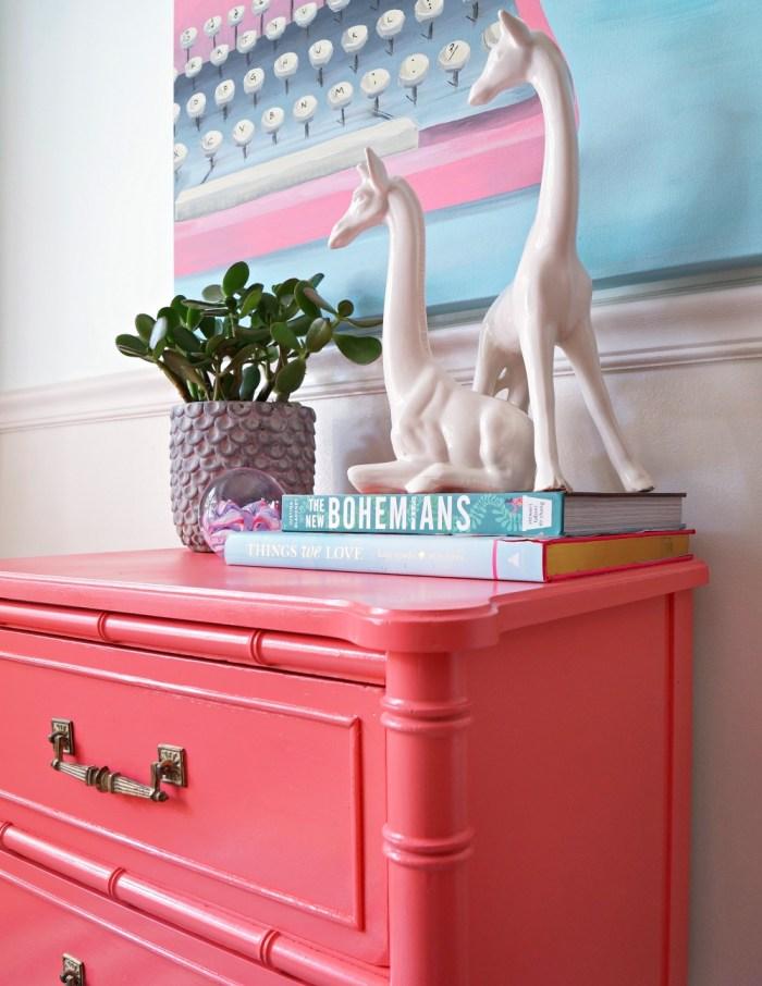 pink-typewriter-painting-coral-bamboo-faux-nightstand-giraffe