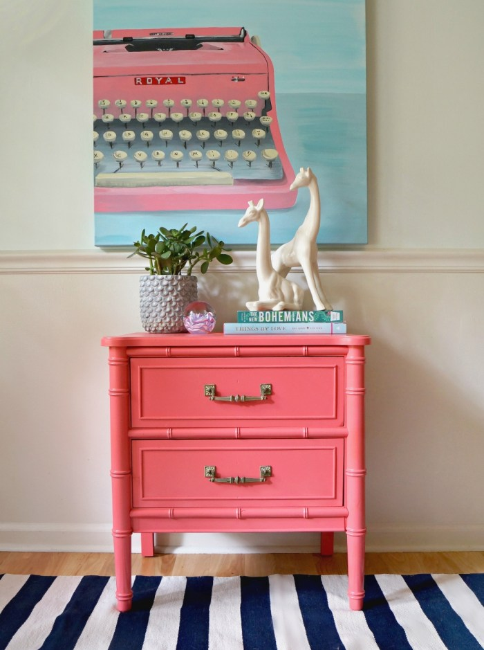 pink-typewriter-painting-coral-bamboo-nightstand-stripes