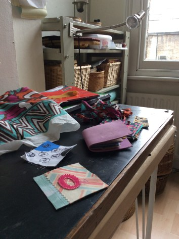 Hand stitched improvisational textile in art studio