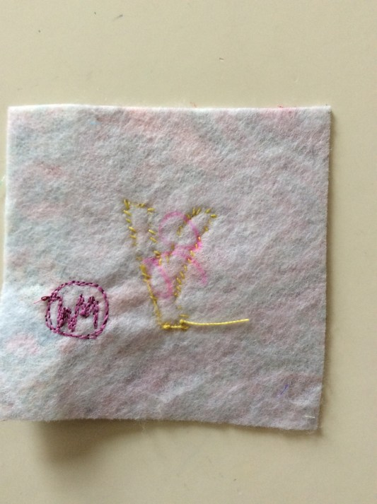 Reverse side of hand stitched contemporary improvisational textile art