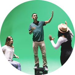 Students acting in front of a green screen