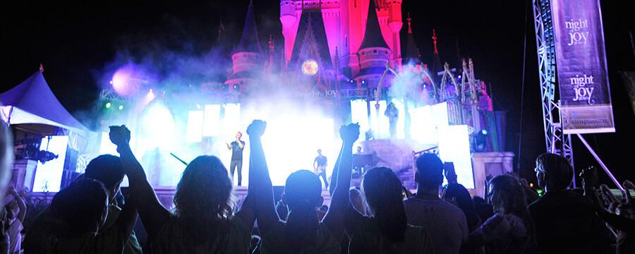 Photo of concert goers enjoying music