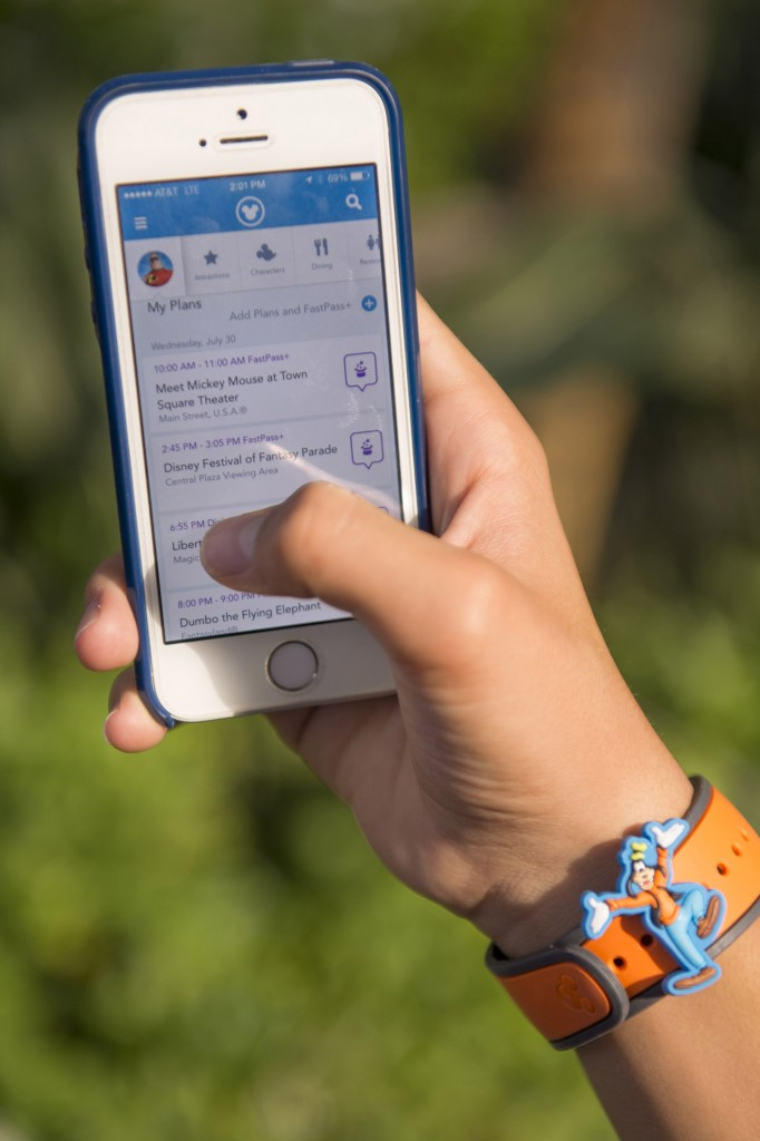With the free My Disney Experience mobile application and extensive complimentary Wi-Fi throughout the Florida Vacation Kingdom, Walt Disney World Resort guests can have Disney fun at their fingertips. Photo by Kent Phillips