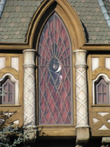 The eveil Queen from Snow White peers out over Fantasyland
