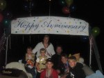 """Family on Wishes Cruise under """"Happy Anniversary"""" banner"""