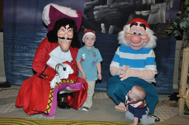 Photo of 2 boys with Captain Hook and Mr. Smee