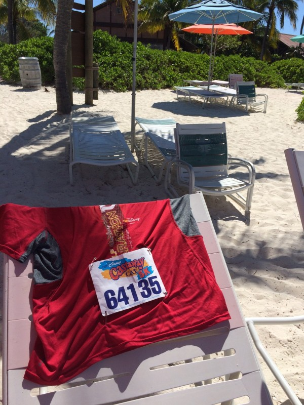 A photo of my race bib from the Castaway Cay 5K on the beach