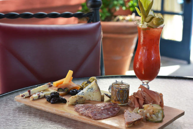Artisanal Cheese and Charcuterie board with Bloody Mary. Photo courtesy of Disney Parks Blogs