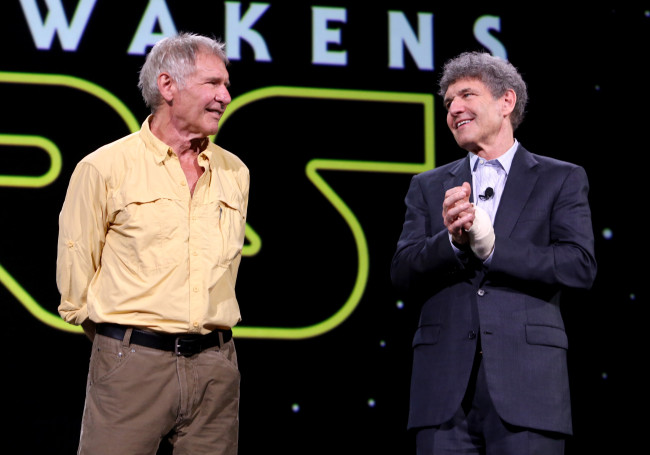 "ANAHEIM, CA - AUGUST 15:  Actor Harrison Ford of STAR WARS: THE FORCE AWAKENS (L) and Chairman of the Walt Disney Studios Alan Horn took part today in ""Worlds, Galaxies, and Universes: Live Action at The Walt Disney Studios"" presentation at Disney's D23 EXPO 2015 in Anaheim, Calif.  (Photo by Jesse Grant/Getty Images for Disney) *** Local Caption *** Harrison Ford; Alan Horn"