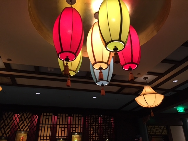 Colorful lights grace the space at Nine Dragons Restaurant in Epcot