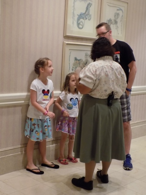 My husband and kids speaking with a Cast Member