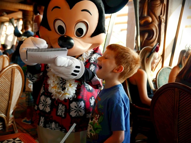 Boy getting Mickey's Autograph at 'Ohana