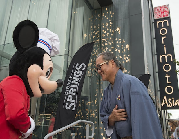 (Sept. 29, 2015): (L-R) Mickey Mouse and Chef Masaharu Morimoto bow in celebration of the opening of Morimoto Asia Sept. 29, 2015 (David Roark, photographer).