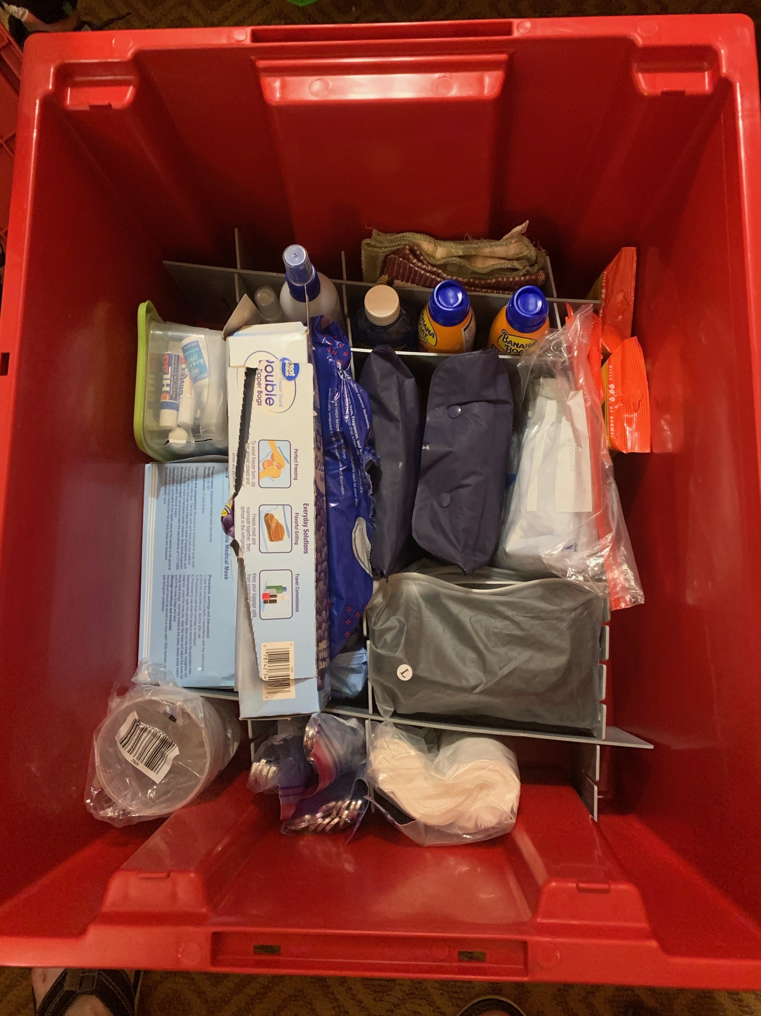 Red Owner's Locker container filled with items
