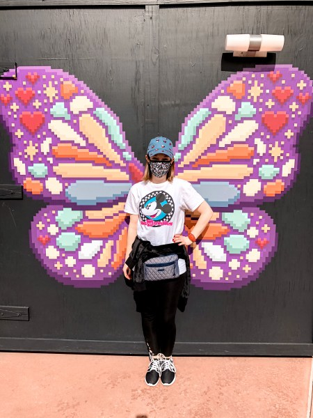 disney blogger magic-ally main street in front of a butterfly at 2021 festival of the arts