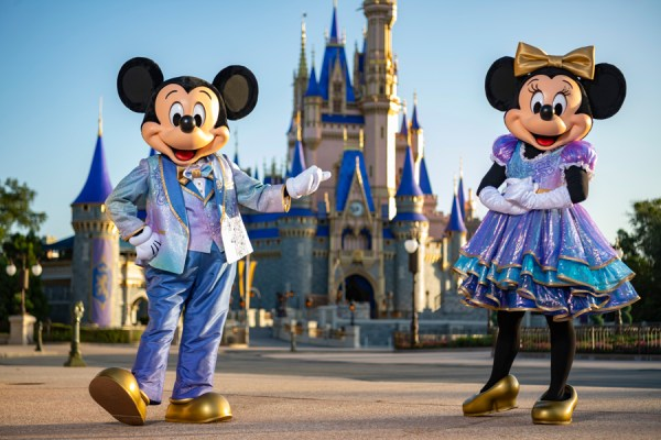 mickey and minnie in new 50th anniversary costumes