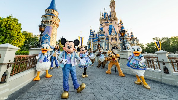 mickey and friends in earidescent costumes