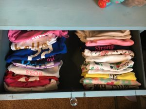 baby onesie drawer folded baby clothes organize