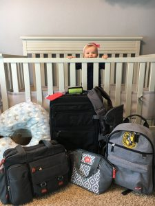 baby packing luggage plane travel vacation suitcase carry on checked bags airport airline airplane crib luggage