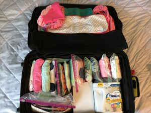 baby packing suitcase formula baby clothes organization airplane travel vacation airport