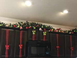magical mama blog christmas decor decorations garland kitchen cabinets ornaments baby proof toddler safe