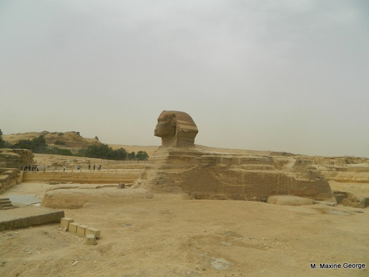 Repair work is done and the Sphinx sits still guarding the complex. Egypt cairo