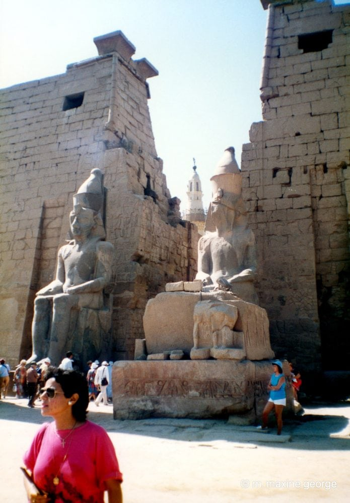 Minaret of Moslem Mosque can be seen at entrance to Luxor Temple