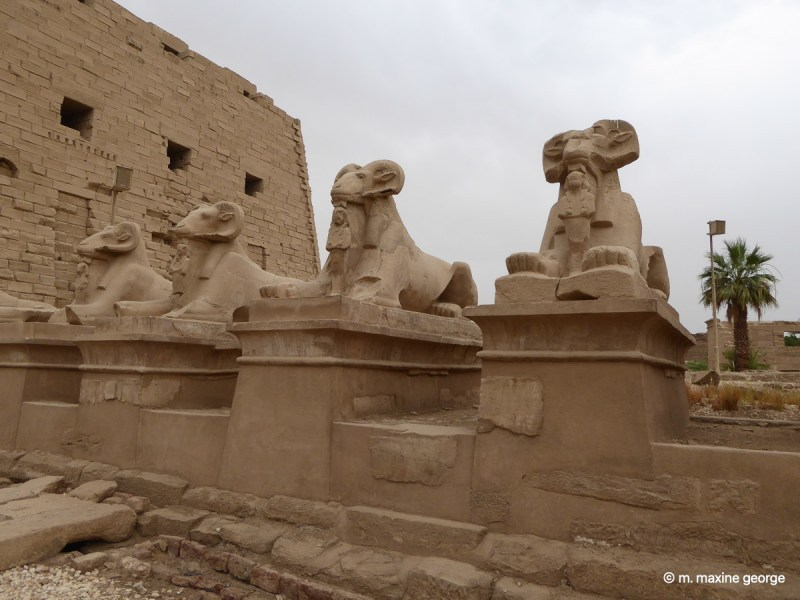 An avenue of ram headed sphinx lead to entrance pylons at Karnak Temple