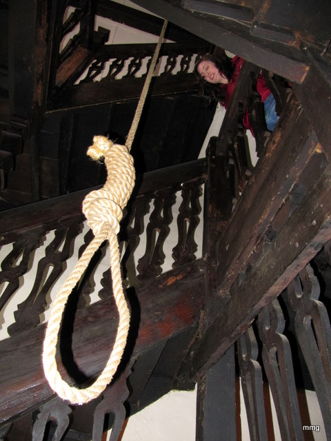 Looking at the hanging rope in stairwell at Skirrid Mountain Inn, Wales. Photo by M. Maxine George