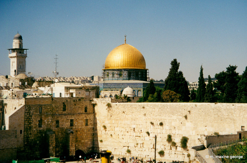 The Wailing Wall with the Dome in the background