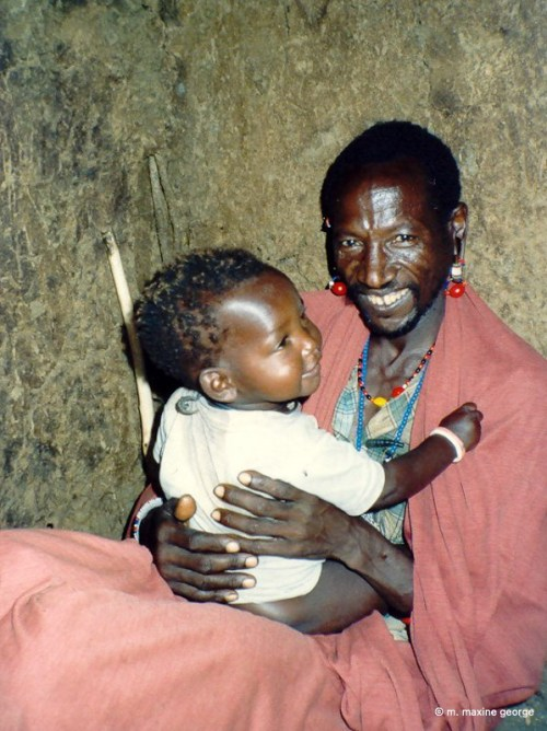 Kenya Masai man holding his baby