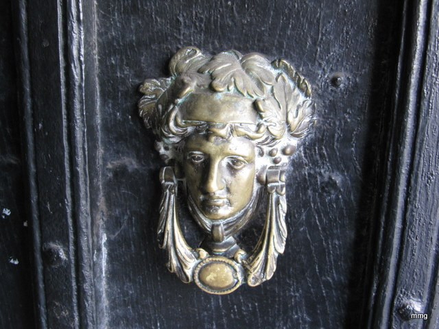 Ancient door knocker at Queens Head Hotel, Monmouth, Wales Picture by M. Maxine George