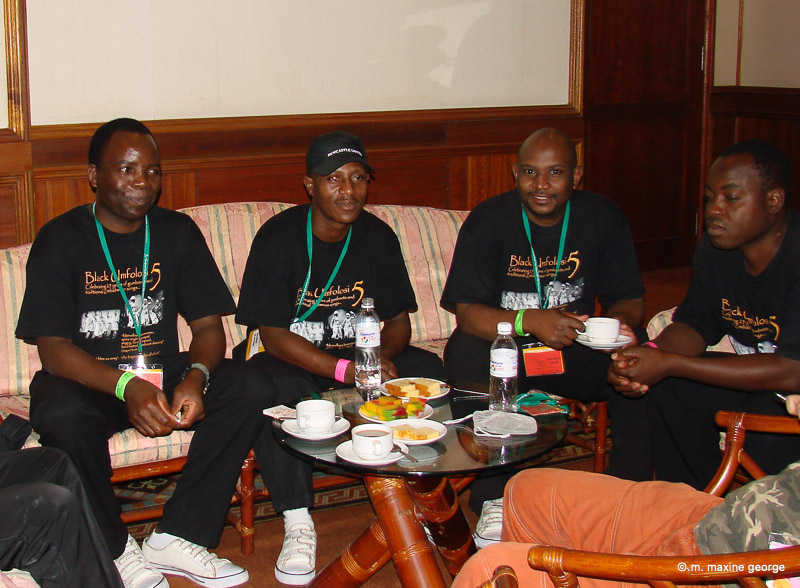 """The """"Black Umfulosi"""" relax between performances at the Rainforest World Music Festival"""