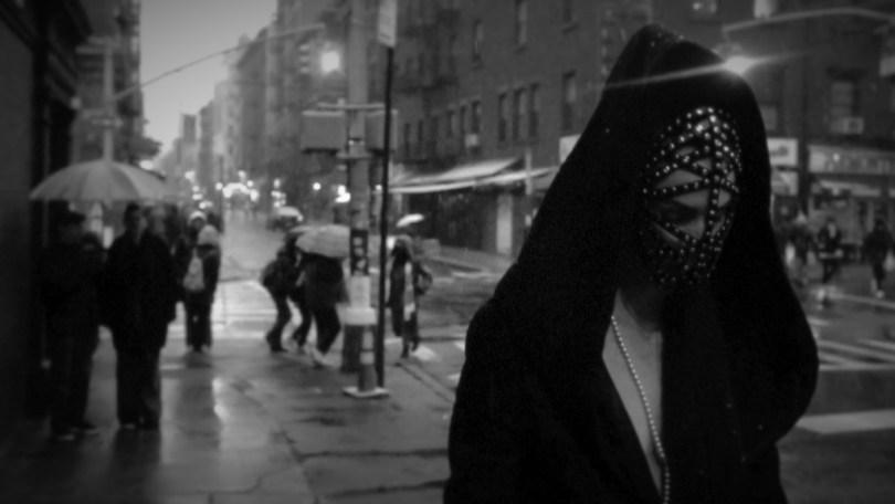 Woman walking the street wearing a beaded harness