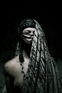Portrait image of a woman draped in fabric
