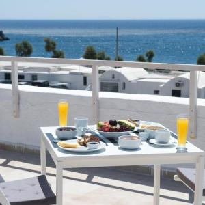 Breakfast on the beach. Rooftop terrace with sea view.