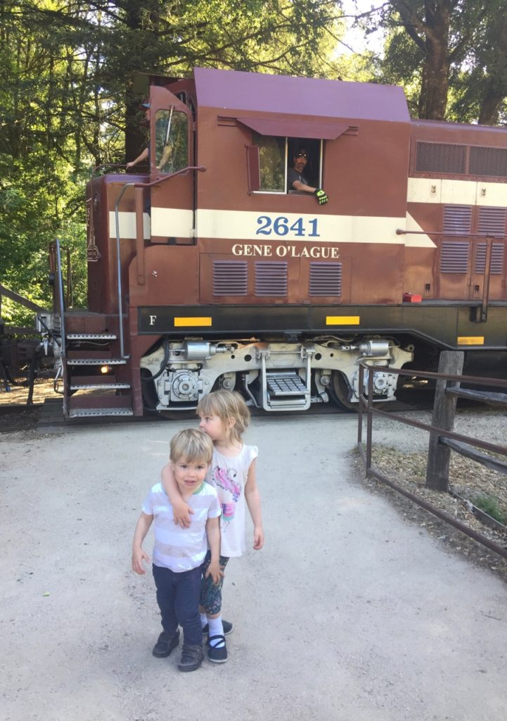 HJ and K pose with the train