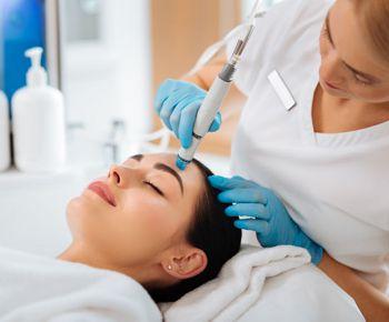woman getting a hydrafacial
