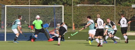 Ben Wright shoots for goal supported by Leigh Sitch (13), James Meek and Andrew Bedwell (2)