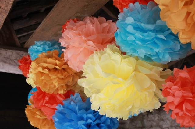 Vintage wedding tissue paper pom pom decorations from the National Vintage Wedding Fair