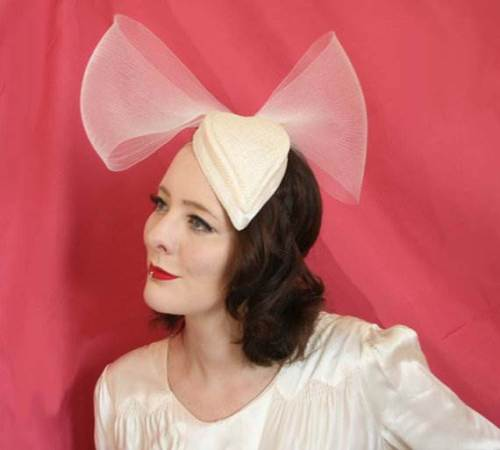 Cream heart bridal hat with bow via BMillinery
