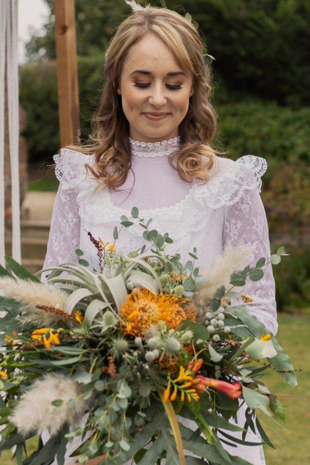 Rustic Vintage Wedding with 1980's Dress Wedding Dress and Orange Flowers