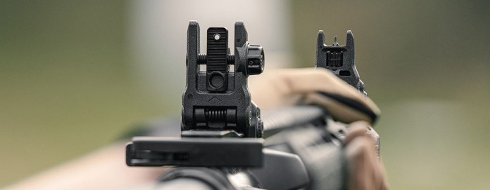 Shooters view of Magpul MBUS 3 Rear Sight and MBUS 3 Front Sight showing serrations on flip aperture