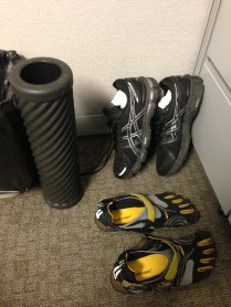 This was the corner of my cube at ORNL: unwearably soaked shoes, Vibrams to walk around the office (got some weird looks), and a foam roller for the IT band.