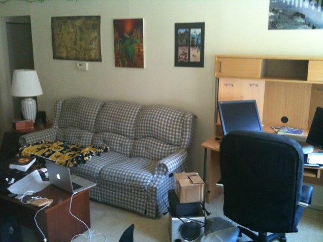The living area of my first apartment. Can't say I miss that couch.