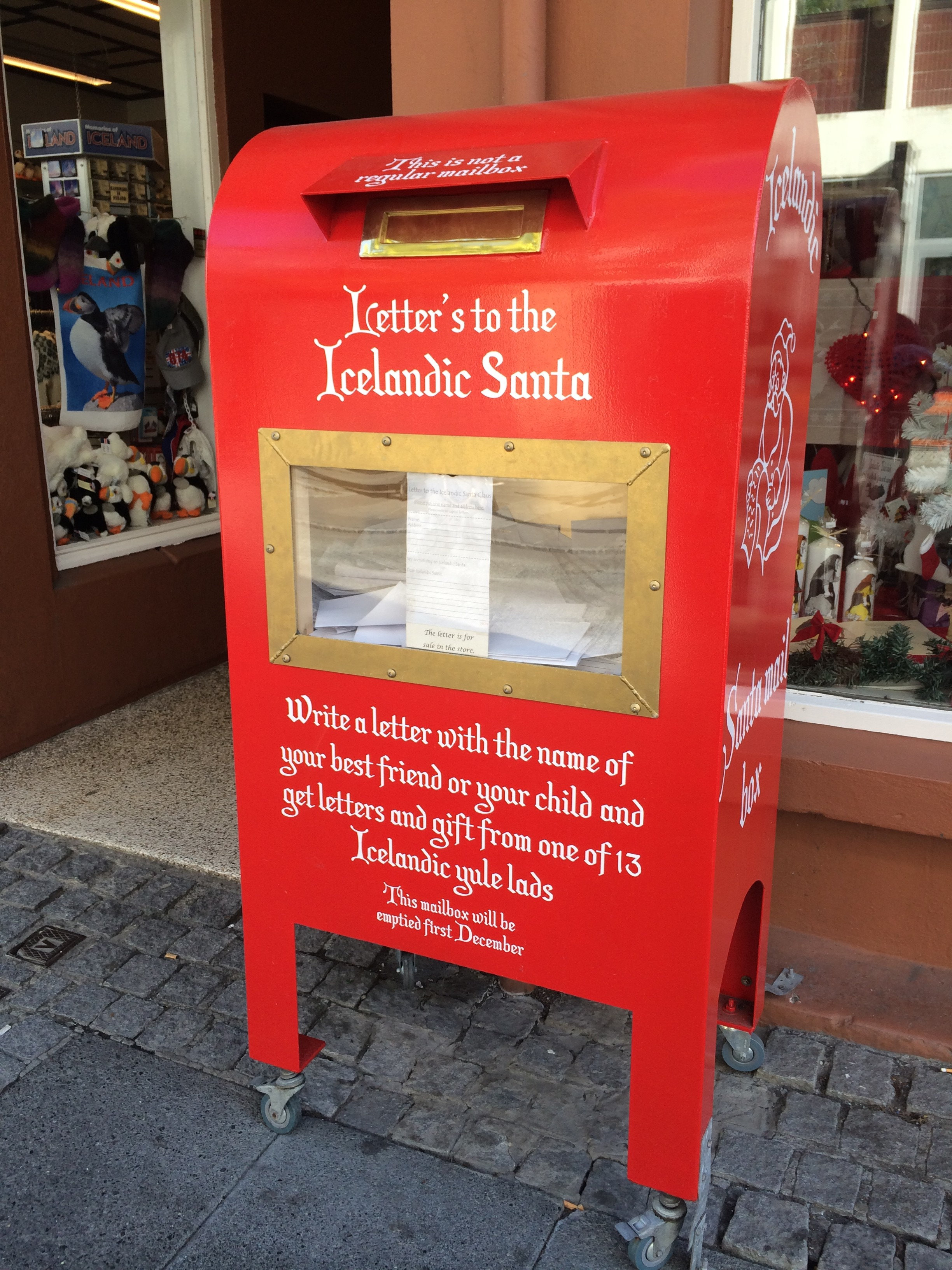 this mailbox is a direct line to icelandic santa the mailbox is located outside of a christmas shop which sells a form letter