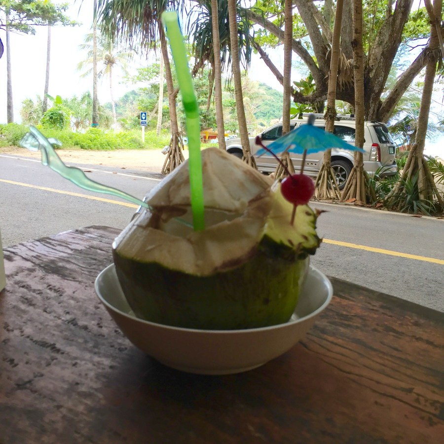 Fresh Coconut Pina Colada on Yanui Beach in Phuket, Thailand.