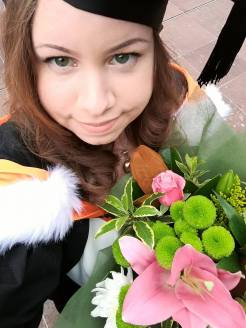 Me at my Official graduation ceremony with flowers from Oli.